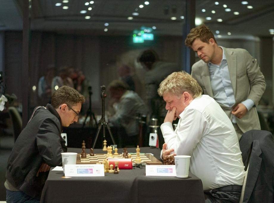 Grand Swiss: Caruana and Wang Hao take the lead
